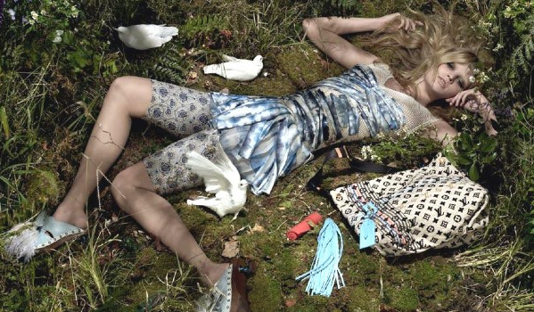 Lara Stone in the grass for Louis Vuitton